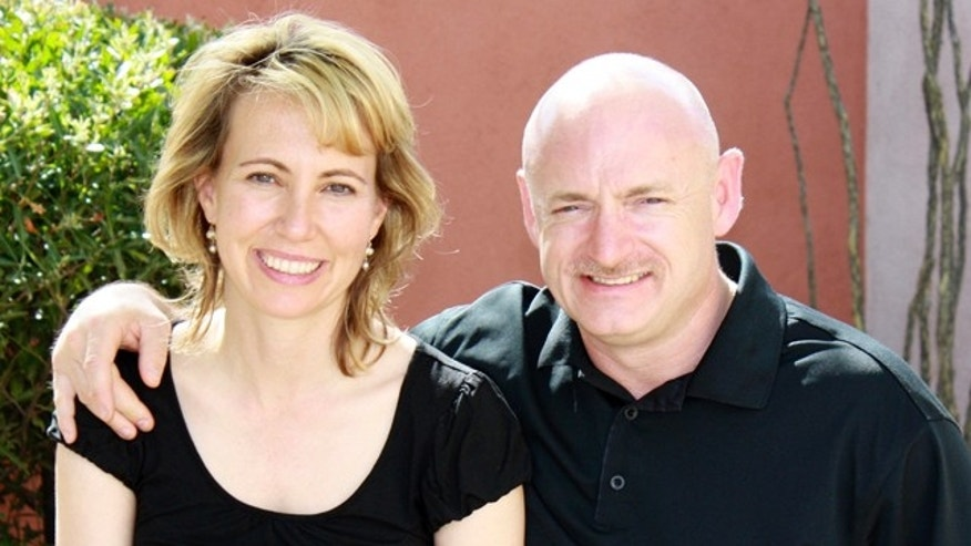 In this file photo provided by the office of Rep. Gabrielle Giffords, Giffords, left, is shown with her husband, NASA astronaut Mark Kelly.