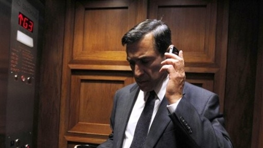 FILE: Rep. Darrell Issa, R-Calif., talks on a phone on an elevator on Capitol Hill in Washington, Tuesday, Sept. 21, 2010.