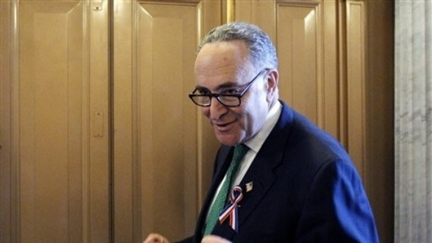 FILE: In this Dec. 22, 2010, photo, Sen. Charles Schumer, D-N.Y., talks with reporters on Capitol Hill.