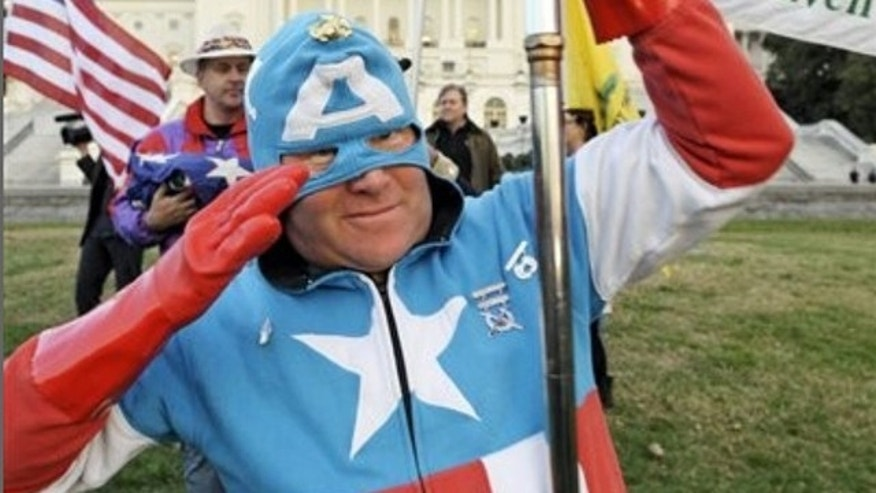 Nov. 2, 2010: Tea Party Patriot, and Captain America, Jim Griffen, of Fort Washington, Md., takes part in an election day demonstration on the lawn of the Capitol in Washington.