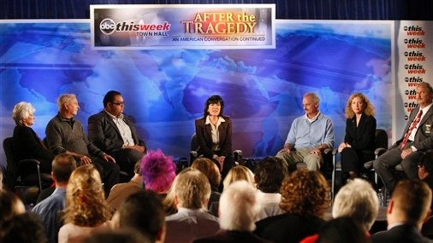 "In this photo released by ABC-TV, ABC News correspondent Christiane Amanpour leads a town hall event at the St. Odilia Church in Tucson, Ariz., during a taping of ""This Week."" The event brought together members of the community and residents who were involved in the shooting in Tucson on Jan. 8, and led to one of the injured being arrested for threatening a Tea Party leader."