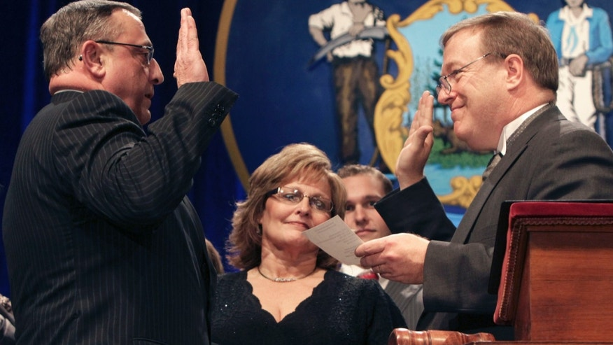 Jan. 5: Republican Paul LePage holds his hand on a Bible as he takes the oath of office while being sworn in as Maine's governor, in Augusta, Maine.  On Jan. 14 when a reporter inquired about LePage's decision not to attend the state NAACP's annual King Day celebrations, LePage answered 'Tell them to kiss my butt.'