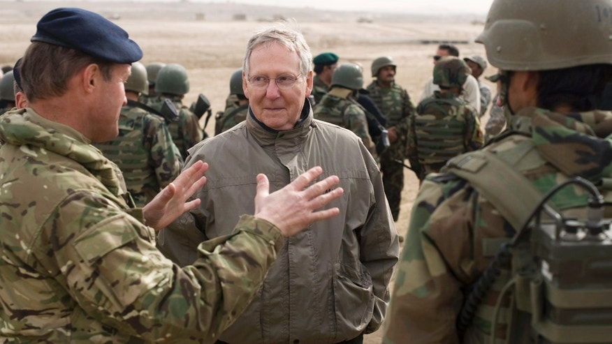 Jan. 16:  In this image provided by NATO Training Mission - Afghanistan, Senate Minority Leader Mitch McConnell of Kentucky speaks to a NATO Training Mission - Afghanistan adviser during a visit to meet Afghan National Army soldiers at the Kabul Military Training Center in Kabul, Afghanistan.