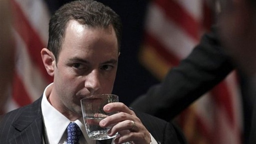 Reince Priebus takes a drink of water after winning the chairmanship during the Republican National Committee Winter Meeting Jan. 14 in Oxon Hill, Md.