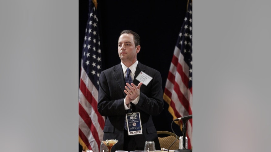 The new elected Republican National Committee (RNC) Chairman Reince Priebus on stage after winning the post during the Republican National Committee Winter Meeting, Friday, Jan. 14, 2011 in Oxon Hill, Md. Priebus was elected after seven rounds of voting, beating four other candidates, including outgoing chairman Michael Steele.(AP Photo/Pablo Martinez Monsivais)