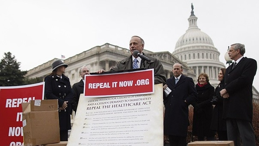Jan. 18: Rep. Steve King, R-Iowa, speaks after accepting delivery of signed petitions demanding the repeal of 'ObamaCare' in Washington.