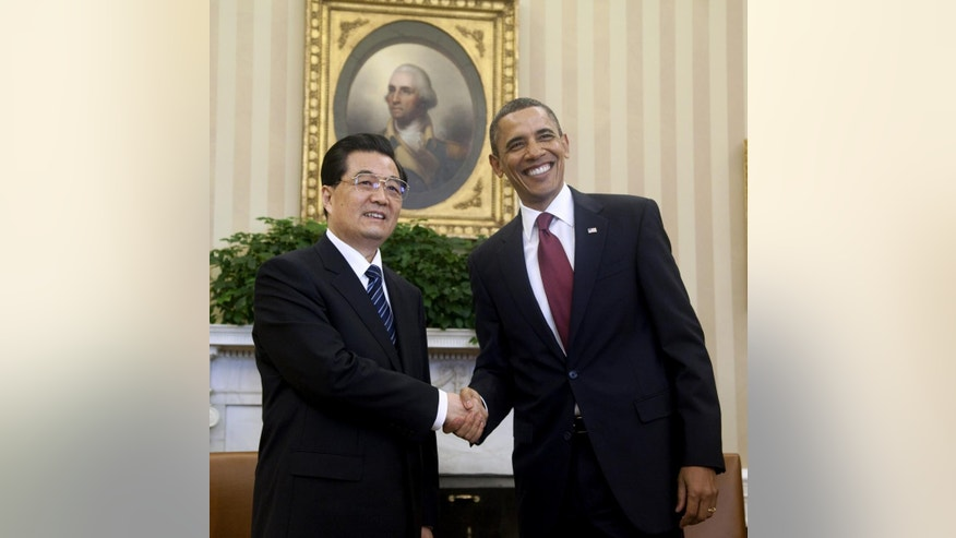 President Barack Obama shakes hands with China's President Hu Jintao, Wednesday, Jan. 19, 2011, in the Oval Office of the White House in Washington. (AP Photo/Evan Vucci)
