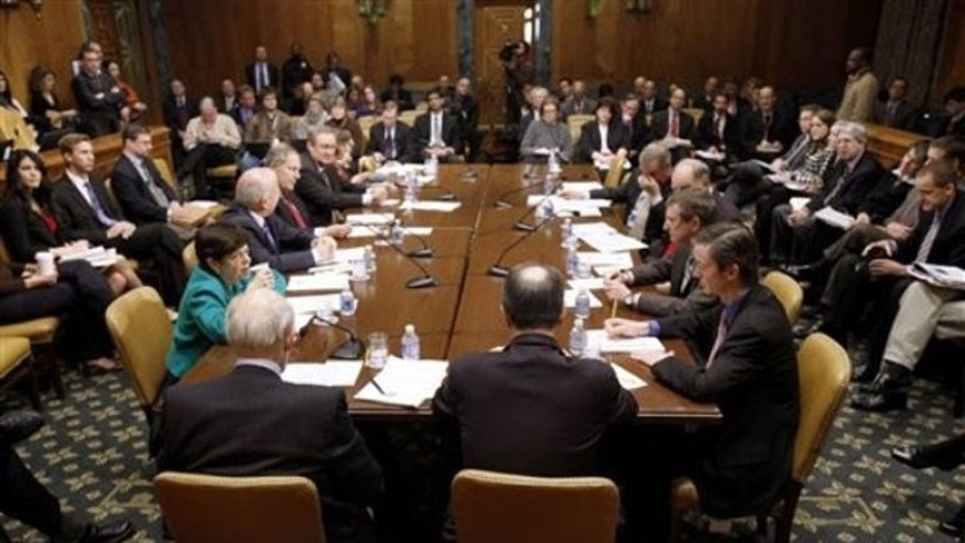The Commission on Fiscal Responsibility and Reform meets on Capitol Hill Dec. 3, 2010.