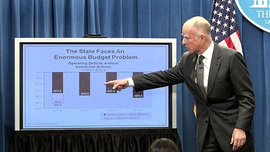 Jan. 10: California Gov. Jerry Brown points to a chart as he explains his approach to dealing with an estimated $25.4 billion state budget deficit during a news conference at the Capitol in Sacramento, Calif.