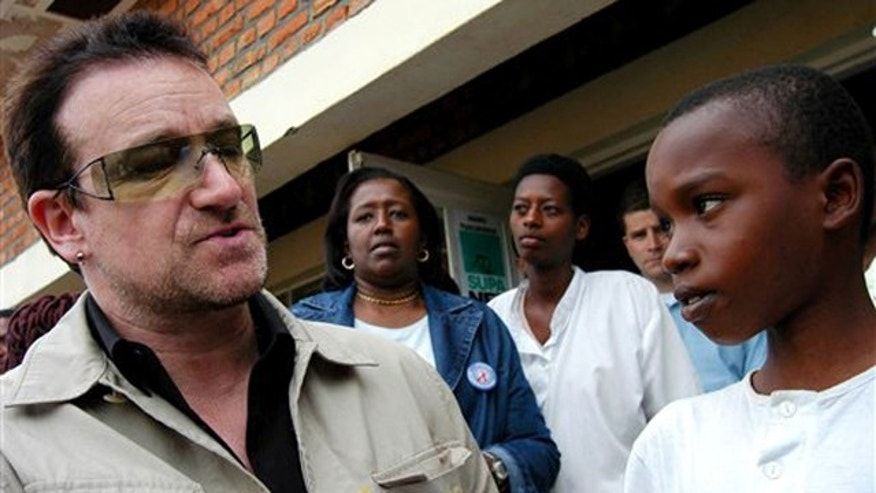 In this May 18, 2006, file photo, Irish rock star Bono meets an unidentified boy suffering from hearth problems at a health center in Mayange, Rwanda. Bono was touring some African nations to support the Global Fund to fight AIDS, malaria and tubercolosis. Bono is not implicated in the fraud.