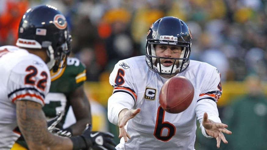 Chicago Bears quarterback Jay Cutler pitches the ball to running back Matt Forte during an NFL football game against the Green Bay Packers in Green Bay, Wis. on  Jan. 2, 2011.  (AP Photo/Matt Ludtke, File photo)