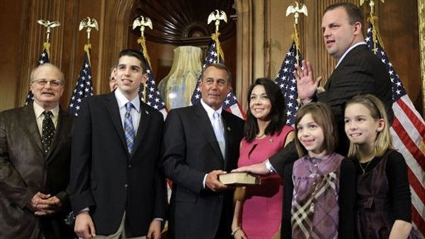 FILE: In this Jan. 5, 2011, photo, Rep. Jon Runyan, R-N.J., is surrounded by his family and House Speaker John Boehner for a ceremonial swearing-in to Congress.