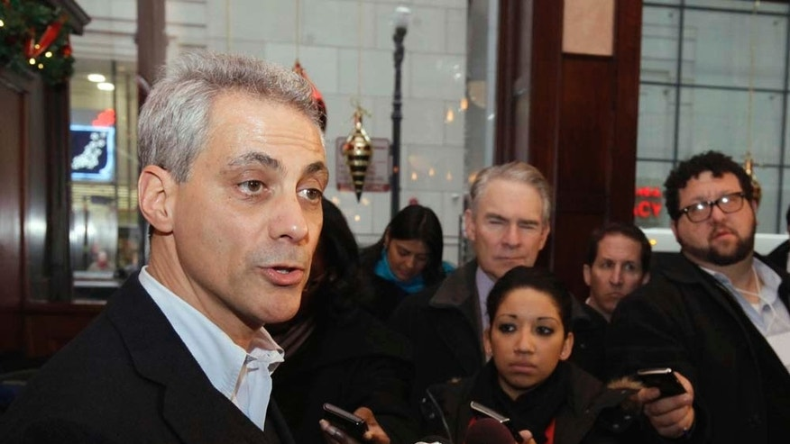 "FILE - In this Dec. 23, 2010 file photo, Chicago mayoral candidate Rahm Emanuel speaks at a press conference in Chicago. Emanuel's rival in the race, Danny Davis issued a news release Tuesday, Dec. 28, 2010, asking former President Bill Clinton to stay out of the Chicago mayor's race after hearing Clinton would be coming to campaig for Emanuel. Davis warned Clinton that he could jeopardize his ""long and fruitful relationship"" with African Americans by choosing Emanuel. (AP Photo/M. Spencer Green, File)"