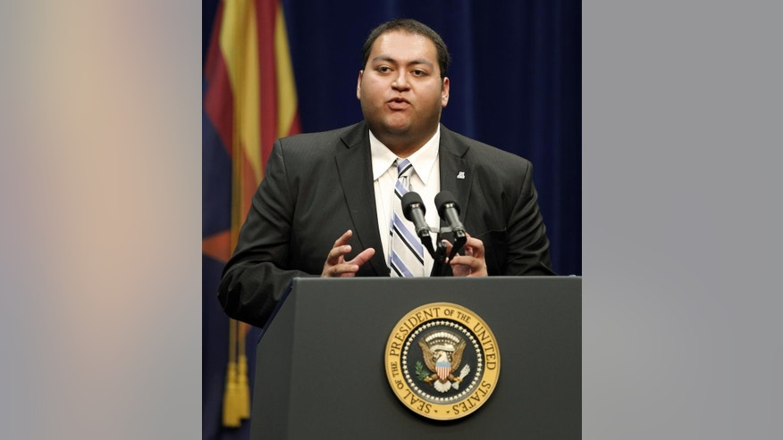 Daniel Hernandez, a intern for Rep. Gabrielle Giffords, speaks at a memorial service for the victims of Saturday's shootings at McKale Center on the University of Arizona campus Wednesday, Jan. 12, 2011, in Tucson, Ariz. (AP Photo/Chris Carlson)