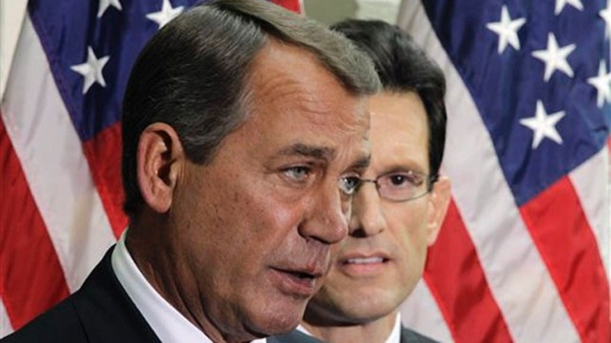 House Speaker John Boehner, accompanied by House Majority Leader Eric Cantor, speaks to reporters Jan. 25 in Washington.