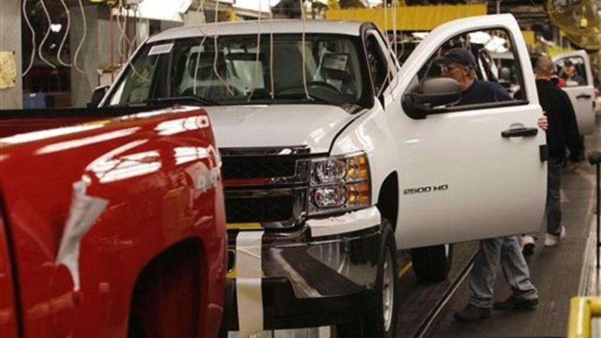 General Motors Silverado and GMC Sierra heavy-duty pickups are assembled at the Flint Assembly plant in Flint, Mich., on Jan. 24.