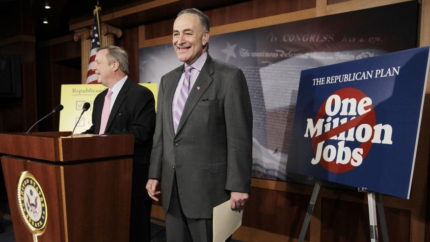 Sen. Charles Schumer, D-N.Y., and Senate Majority Whip Richard Durbin of Ill., talk about jobs, Wednesday, Jan. 26, 2011, on Capitol Hill in Washington. (AP Photo/Charles Dharapak)