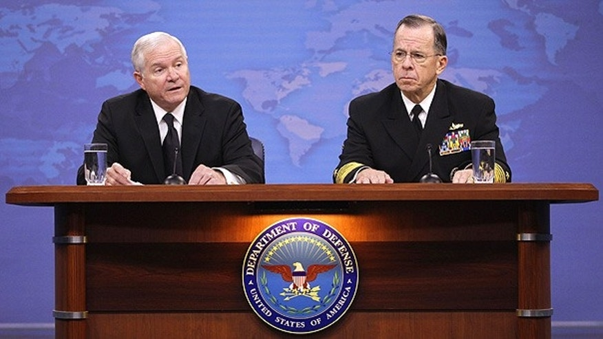 Nov. 30: Defense Secretary Robert Gates, left, and Joint Chiefs Chairman Adm. Mike Mullen discuss gays in the U.S. military at the Pentagon.
