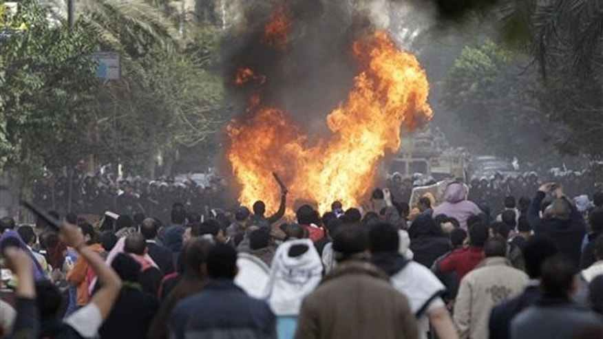 Protesters throw firebombs at riot police after police shot at protesters accompanying the funeral procession of an anti-government protester in downtown Cairo, Egypt, Jan. 29.