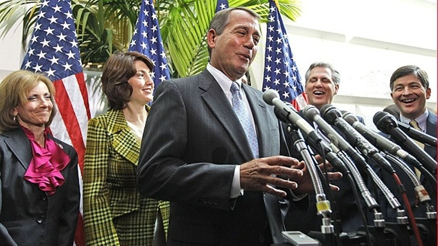FILE: In this Jan. 19, 2011, photo, House Speaker John Boehner, flanked by GOP representatives, speaks about the health care law repeal vote.