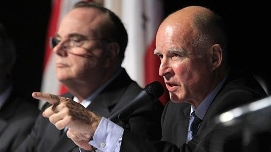 Dec. 8: Gov.-elect Jerry Brown, right, points to a member of the audience for a question as Treasurer Bill Lockyer looks on at Brown's budget briefing in Sacramento, Calif.