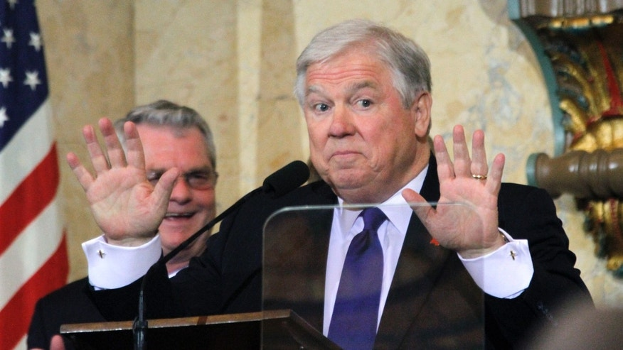 FILE: Then-Gov. Haley Barbour gestures to lawmakers that they take their seats and cease their applause so he can deliver his eighth and final State of the State address.