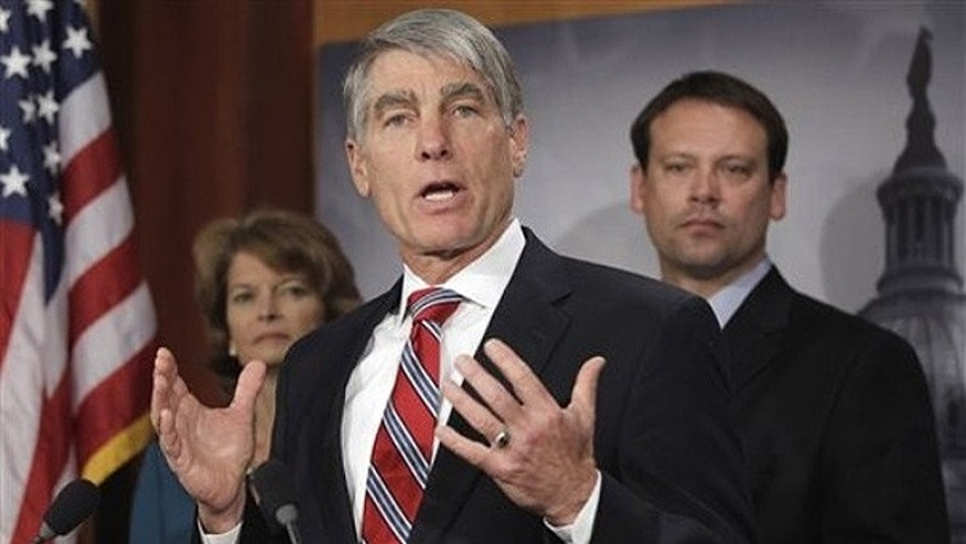 Jan. 25: Sen. Mark Udall, D-Colo., center, is flanked by Sen. Lisa Murkowski, R-Alaska, and Rep. Heath Shuler, D-N.C., during a news conference on Capitol Hill.