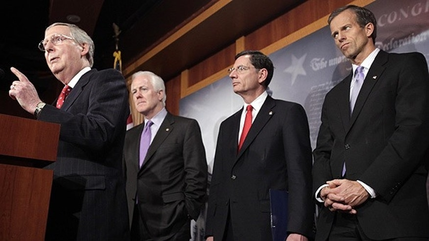 Feb. 2: Senate Republican leader Mitch McConnell, left, and other GOP senators, speak about the health care law repeal in Washington.
