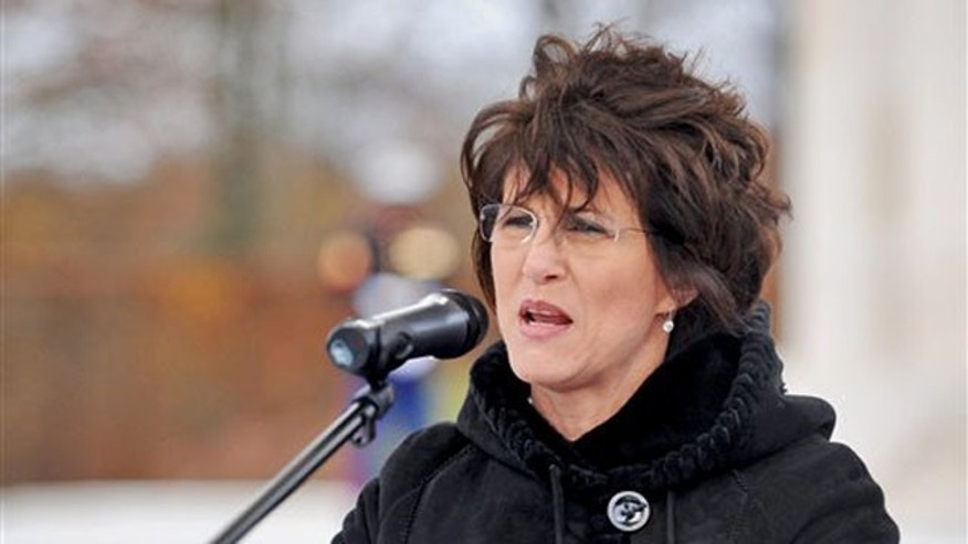 In this Nov. 11, 2010, photo released by the U.S. Air Force, then-U.S. Ambassador to Luxembourg Cynthia Stroum speaks to a crowd at the Luxembourg American Cemetery and Memorial.