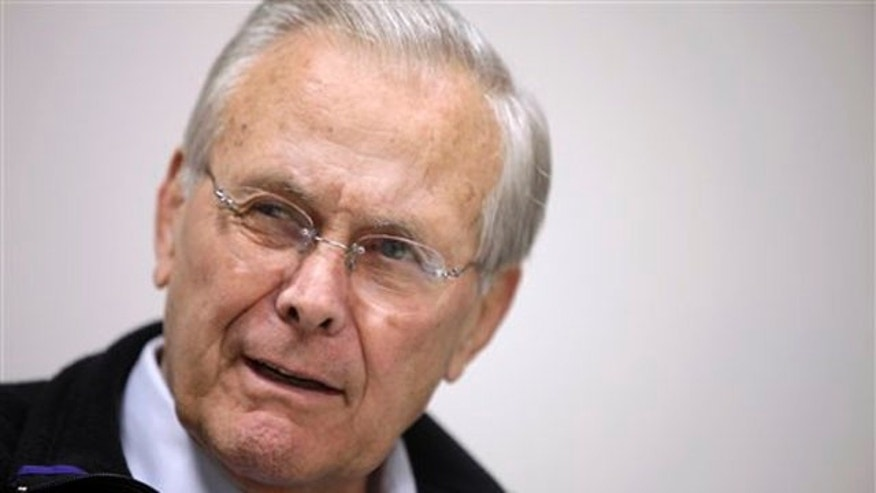 In this 2011 photo, former Defense Secretary Donald Rumsfeld is interviewed at his office in Washington.