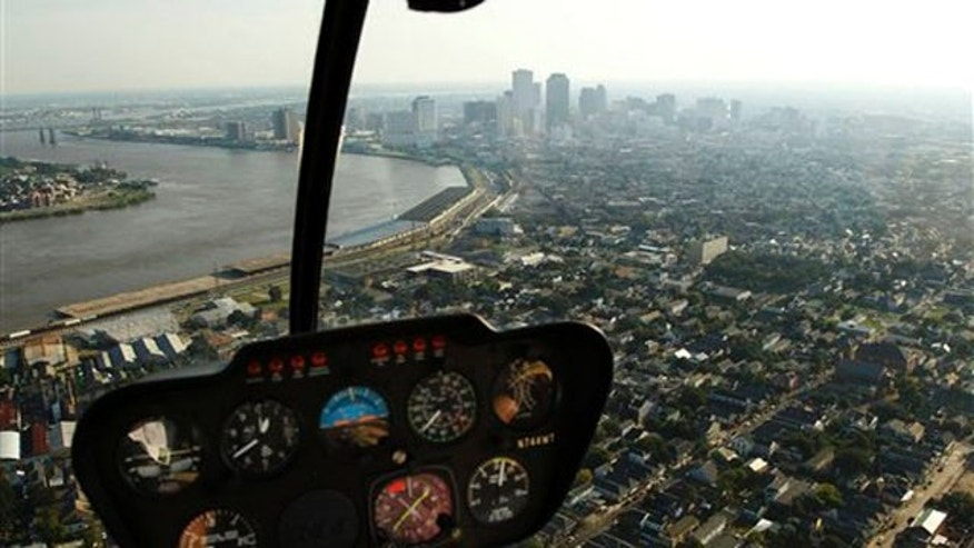 In this July 31, 2010 photo, the New Orleans skyline is seen from the cockpit of a helicopter.