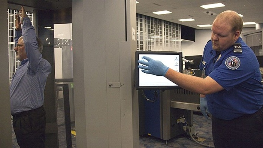 Feb. 1: Transportation Security Administration supervisor Nick Fox, right, demonstrates new software being tested with advanced imaging technology at McCarran International Airport in Las Vegas.