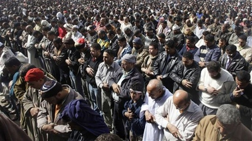 Anti-government protestors pray in Tahrir Square, in Cairo, Egypt, Feb. 4.