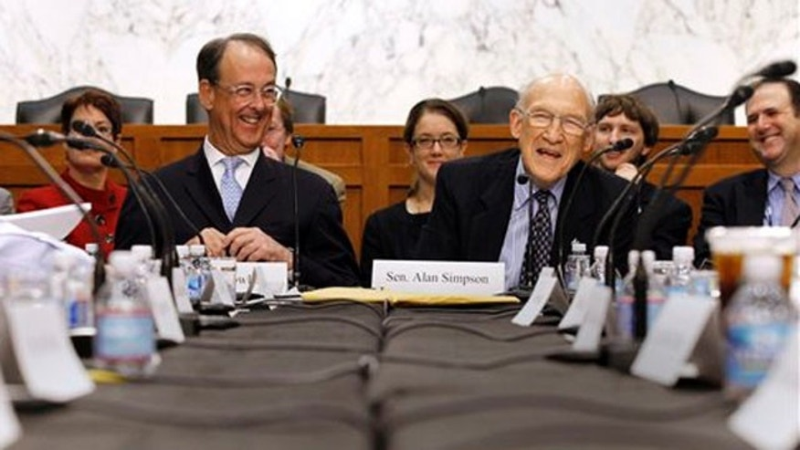 FILE: Debt commission co-chairmen former Wyoming Sen. Alan Simpson, right, and Erskine Bowles took part in a meeting on Capitol Hill in Washington, Wednesday, Dec. 1, 2010, before failing to win a supermajority of the panel making recommendations to Congress.