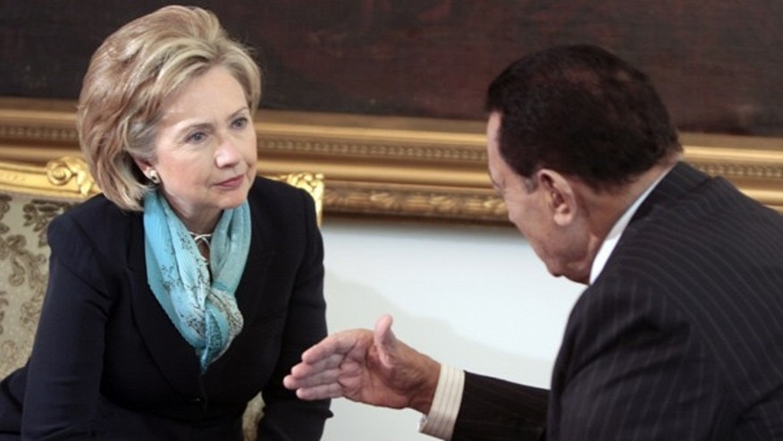 FILE: In this Nov. 4, 2010, photo, Secretary of State Hillary Clinton listens to Egyptian President Hosni Mubarak at the Presidential Palace in Cairo, Egypt.