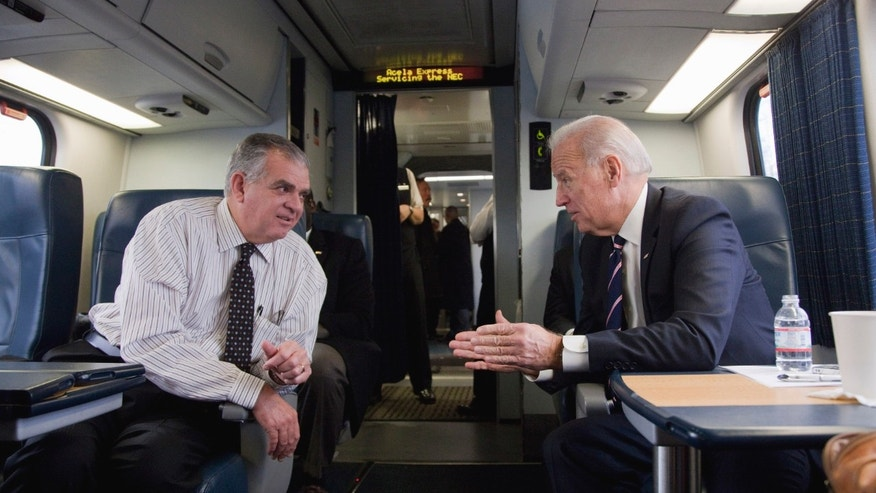 Feb. 8: Joe Biden, talks with Transportation Secretary Ray LaHood on a train heading to Philadelphia.