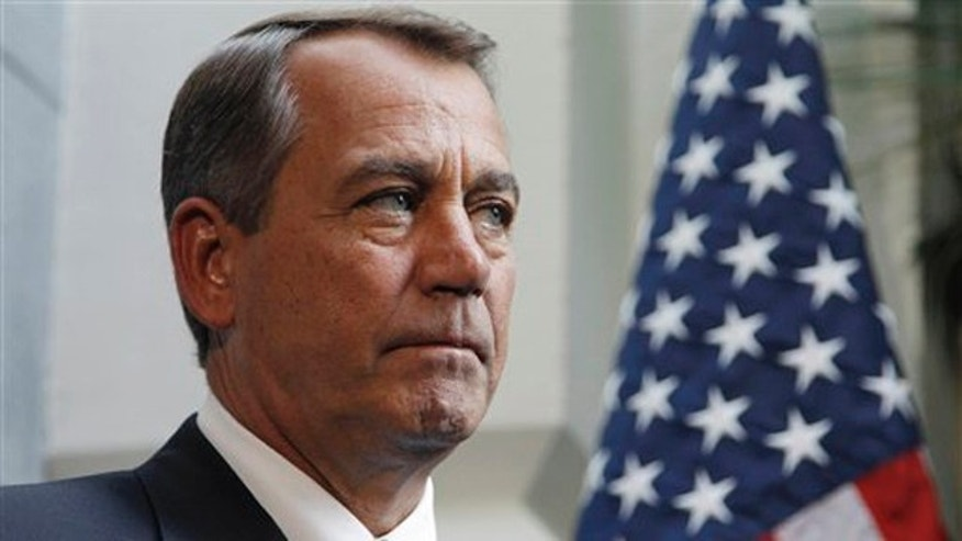 House Speaker John Boehner waits to speak Feb. 9 before his lunch meeting with President Obama in Washington.