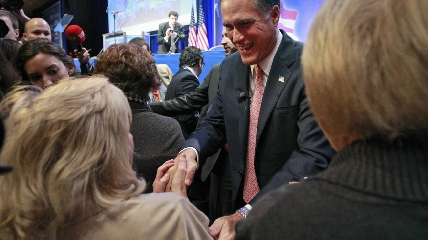 Mitt Romney shakes hands after speaking at the Conservative Political Action Conference (CPAC) in Washington, Friday, Feb. 11, 2011.(AP Photo/Alex Brandon)
