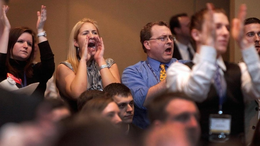The crowd cheers for Rep. Ron Paul, R-Texas, at the Conservative Political Action Conference in Washington, on Friday, Feb. 11, 2011. (AP Photo/Jacquelyn Martin)