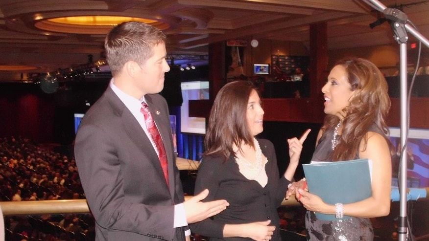 Rep. Sean Duffy and wife Rachel Campos-Duffy talk to Fox News's Uma Pemmaraju at the Conservative Political Action Conference.