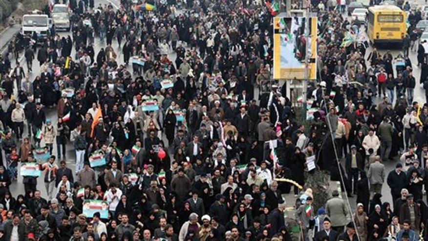 Iranians attend a rally marking the 32nd anniversary of the 1979 Islamic Revolution, in Tehran Feb. 11.