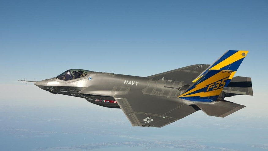 In this Feb. 11, 2011 photo released by the U.S. Navy, a variant of the F-35 Joint Strike Fighter, the F-35C, conducts a test flight over the Chesapeake Bay.  (AP Photo/U.S. Navy, Lockheed Martin)