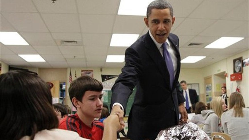 Monday: President Obama visits with students in a science class at Parkville Middle School and Center of Technology, in Parkville, Md.