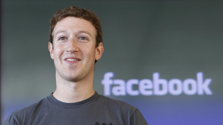 In this Nov. 15, 2010 file photo shows Facebook CEO Mark Zuckerberg smiling at an announcement in San Francisco (AP Photo/Paul Sakuma, file)