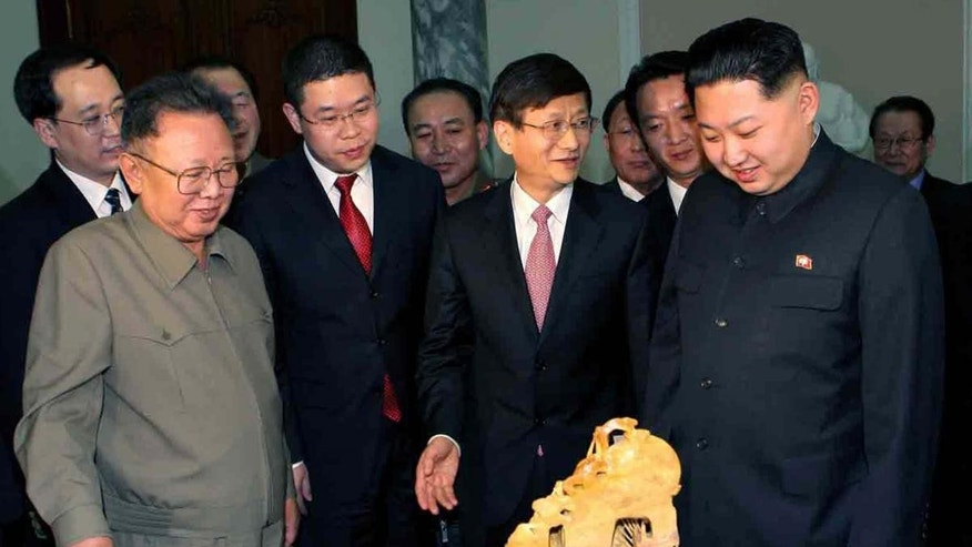 This photo released by Korean Central News Agency via Korea News Service in Tokyo Tuesday, Feb. 15, 2011, shows North Korean leader Kim Jong Il, front left, and his son Kim Jong Un, front right, looking at the gifts brought by visiting Chinese Minister of Public Security Meng Jianzhu, center, in Pyongyang, North Korea, on Monday, Feb. 14, 2011. (AP Photo/Korean Central News Agency via Korea News Service)