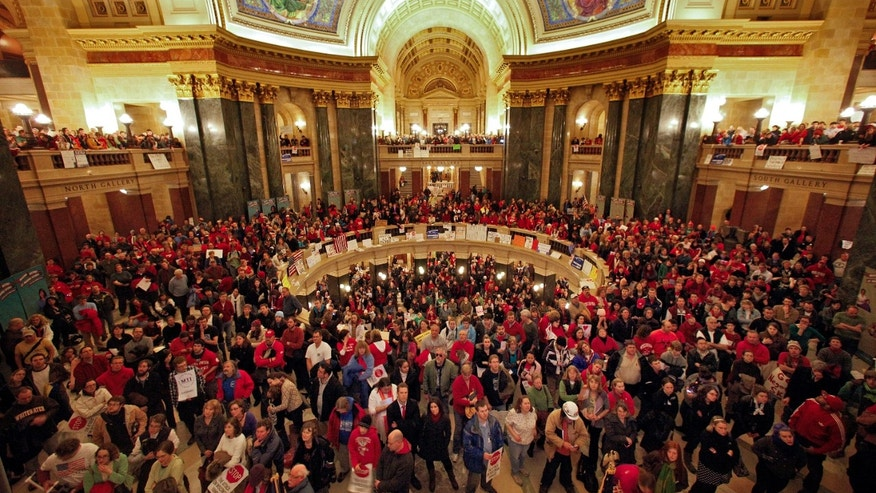 Feb. 16: Protesters to Wisconsin Gov. Scott Walker's proposal to eliminate collective bargaining rights for many state workers gather in the rotunda at the State Capitol in Madison.