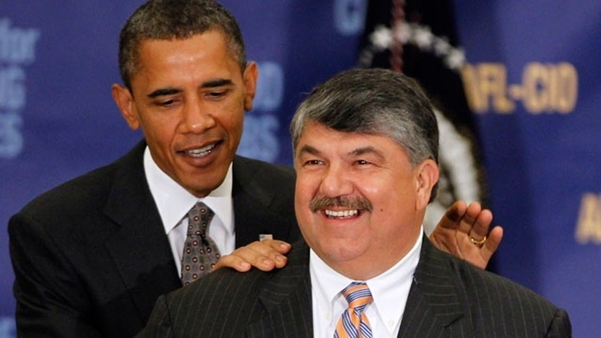 In this Aug. 4, 2010, file photo President Barack Obama stands with AFL-CIO Presidet Richard Trumka after speaking about jobs and the economy in Washington.