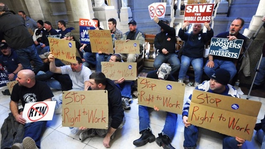 Union members from throughout Indiana protest several anti-labor bills outside the Senate chambers at the Indiana Statehouse, Tuesday, Feb. 22, 2011, in Indianapolis. (AP)