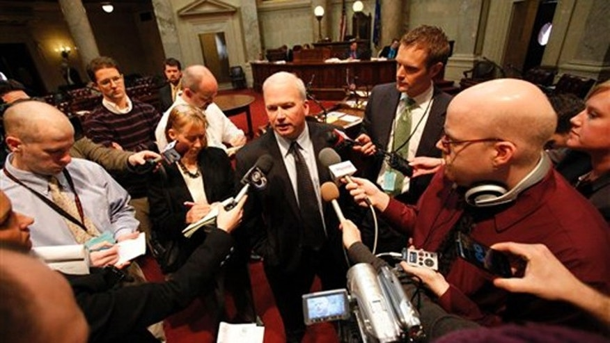 FILE: State Senate Majority Leader Scott Fitzgerald addresses the media on the Senate floor in Madison, Wis., Feb. 18.
