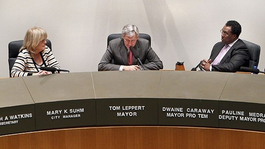 Feb. 23: Dallas City Manager Mary Suhm, left, and Dallas Mayor Pro Tem Dwaine Caraway, right, listen as Dallas Mayor Tom Leppert pauses during his resignation address.